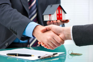 Commercial property exchange parties shake hands