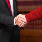 Goldstein Legal commercial lawyers shake hands with client
