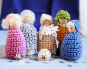 Knitted toy carol singers