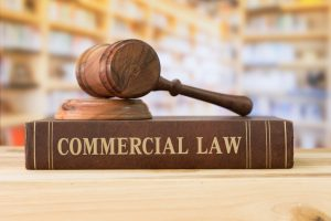 Judges hammer with commercial law book