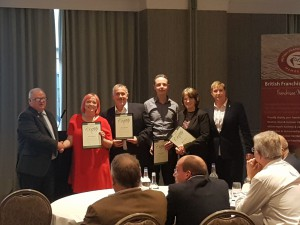 Roz Goldstein collecting her QFP certificate with fellow QFPs at bfa AGM 2016